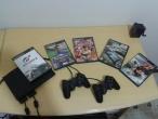 PS2 em ótimo estado com 2 controles, 5 jogos originais e memory card.